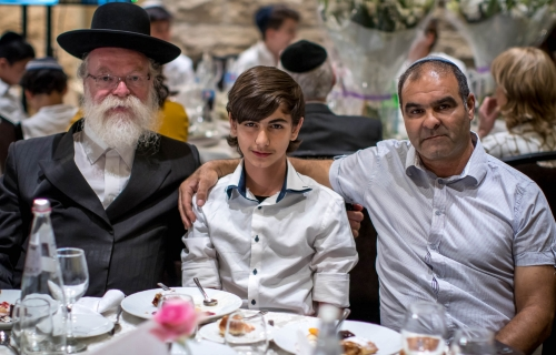 Menahel-BarMitzvah-boy-and-his-parent